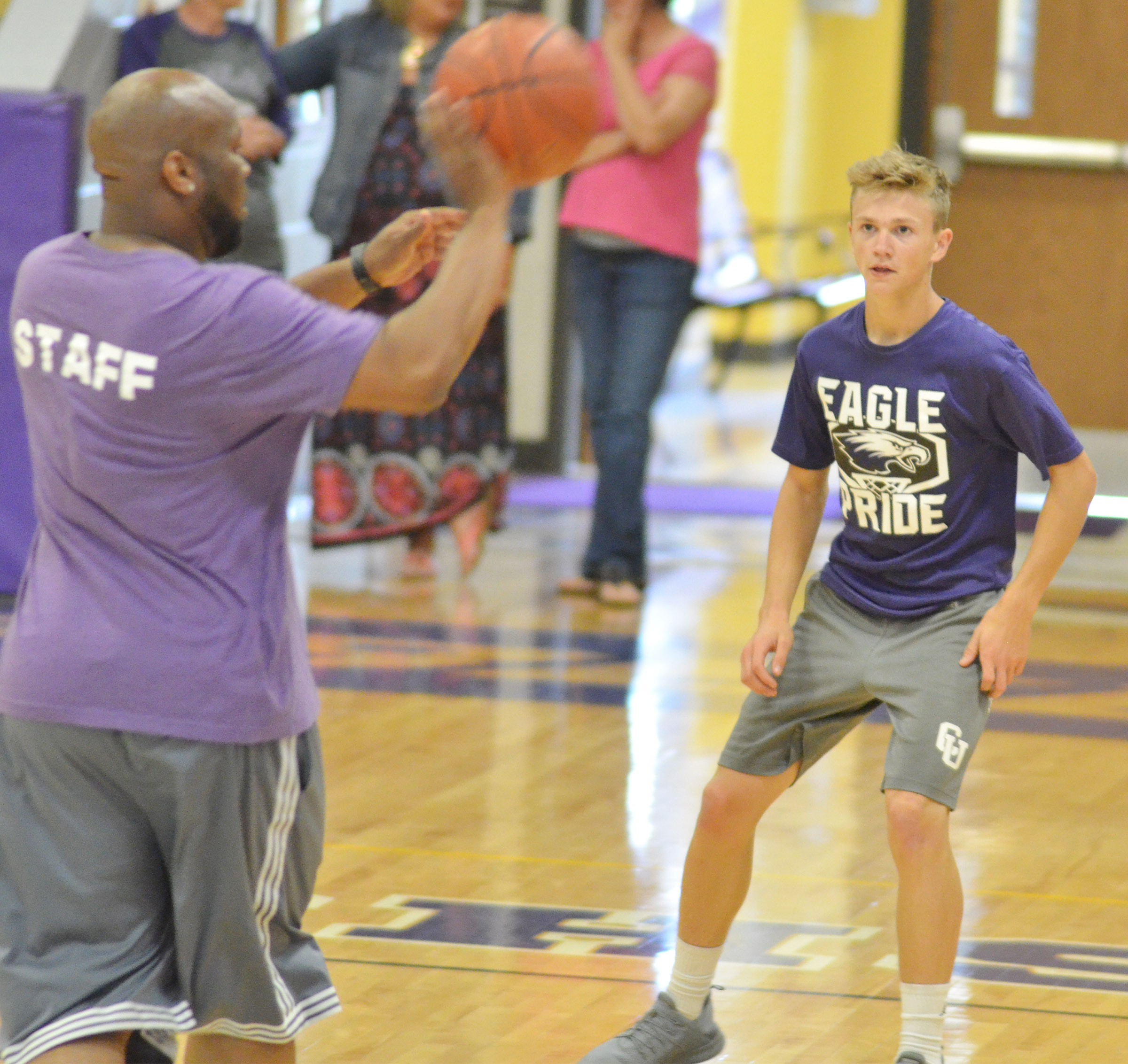 CMS eighth-grader Blase Wheatley guards exceptional education teacher Anthony Epps.