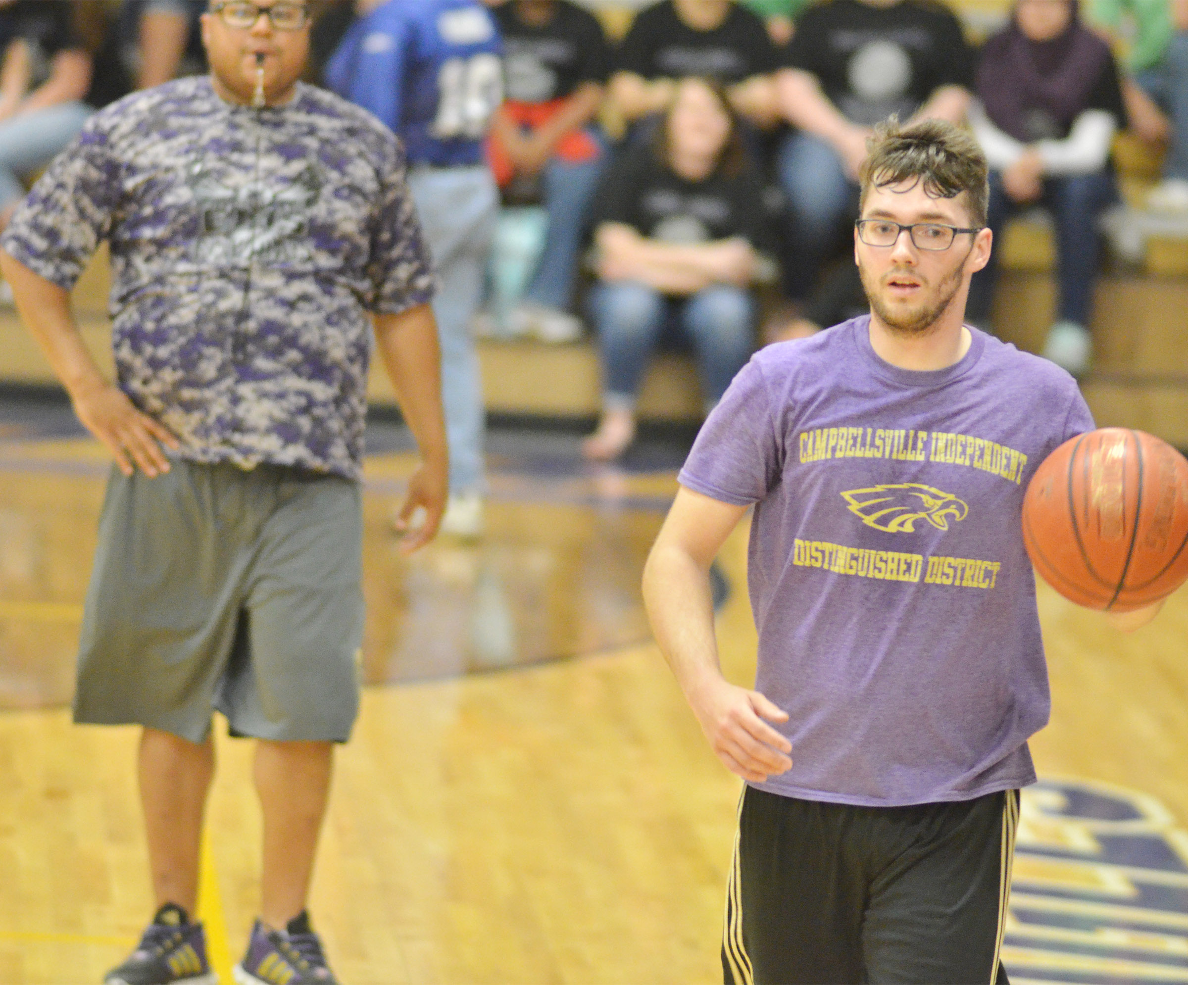 Campbellsville High School instructional assistant Cody Wills dribbles to the basket.