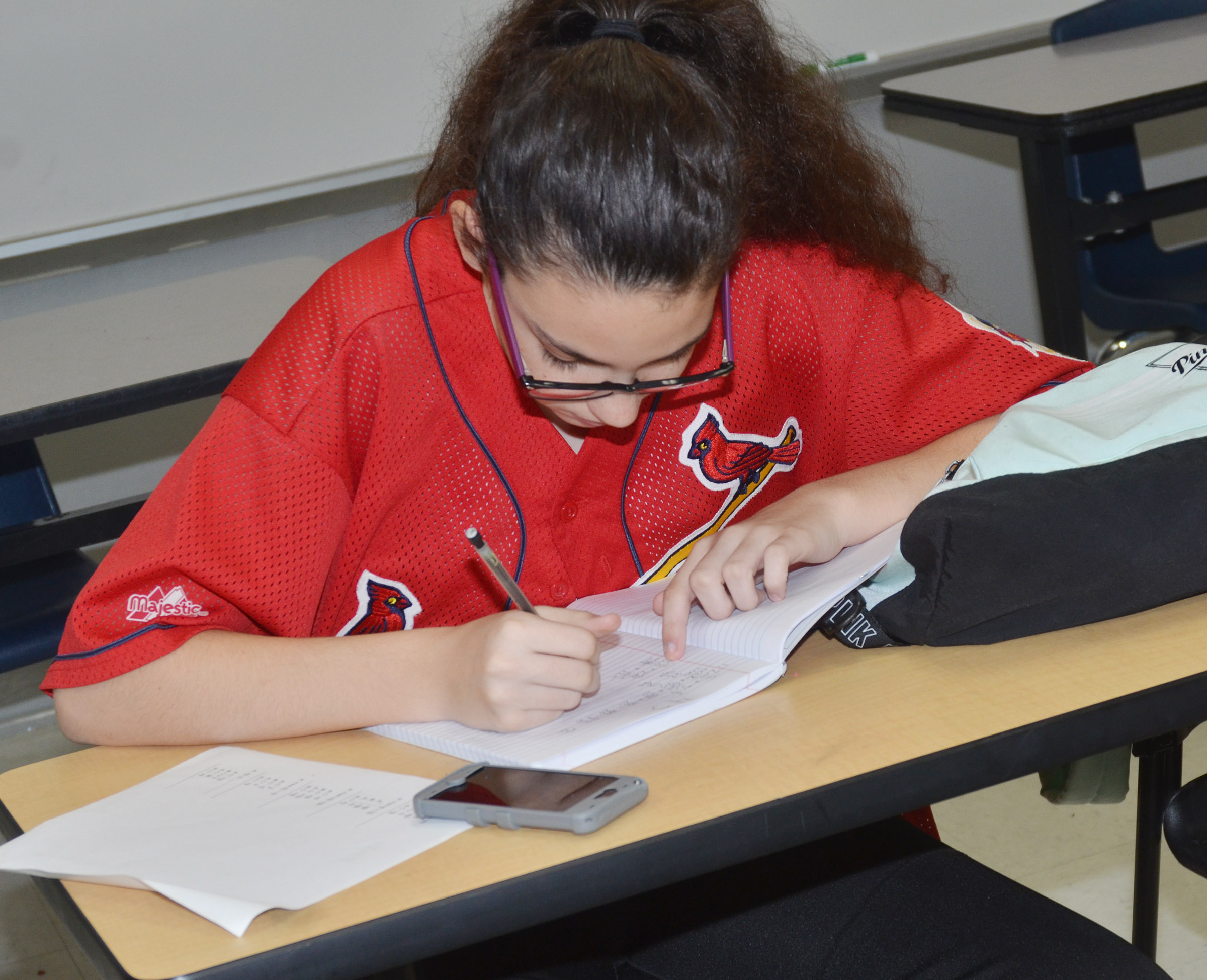 CMS seventh-grader Mary Russell works on homework during the after-school study session on Friday, Oct. 27.