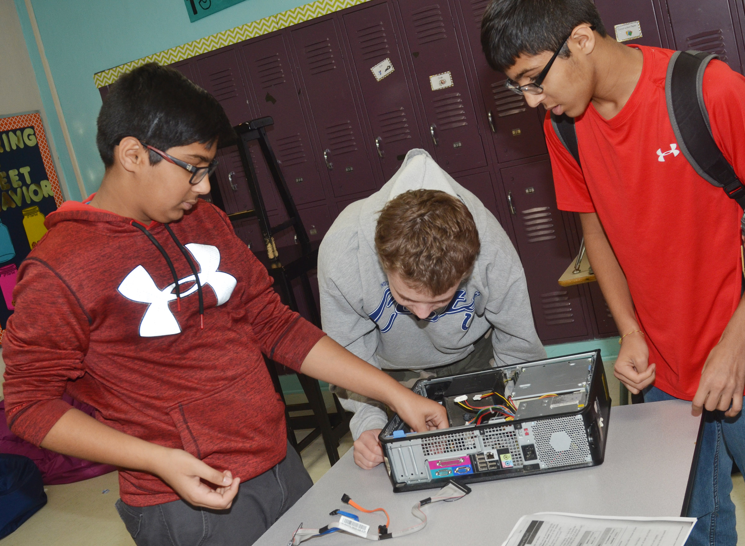 From left, CMS eighth-graders Yash Patel and Brandon Castellano and Campbellsville High School freshman Raj Patel work to repair a computer during the after-school study session on Friday, Oct. 27.
