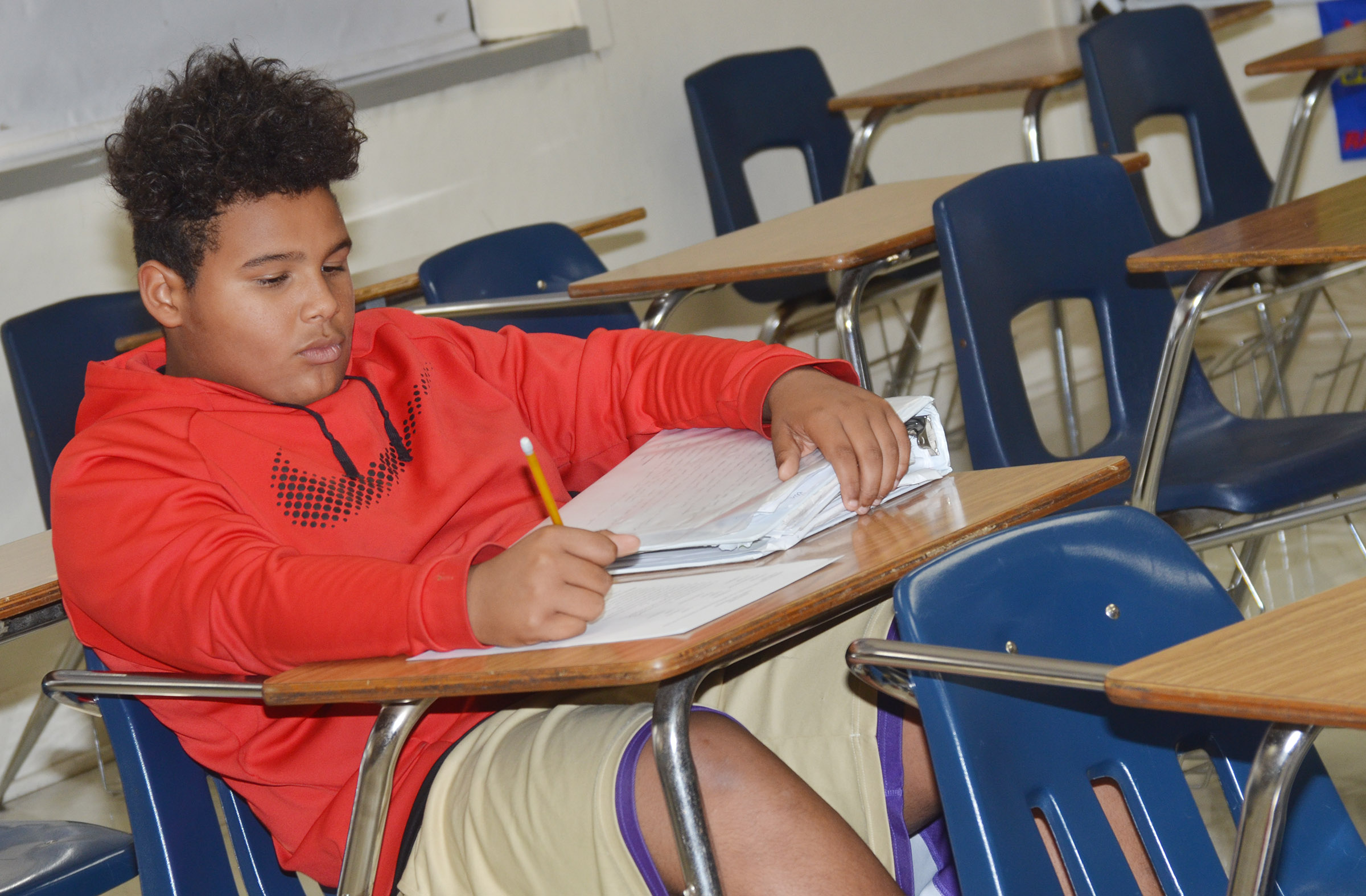 CMS seventh-grader J.T. Washington works on an exam during the after-school study session on Friday, Oct. 27.
