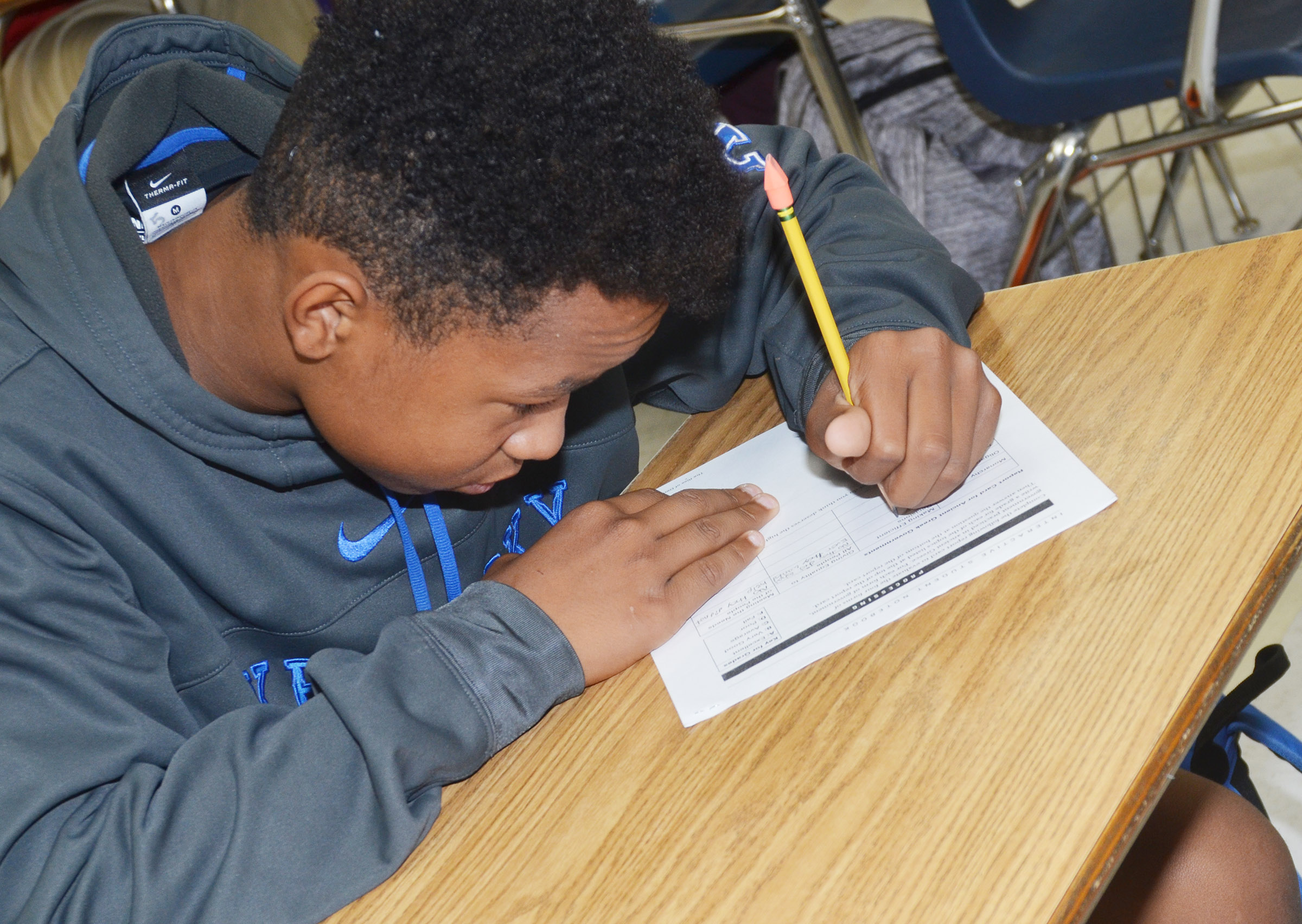 CMS seventh-grader Deondre Weathers works on an exam during the after-school study session on Friday, Oct. 27.