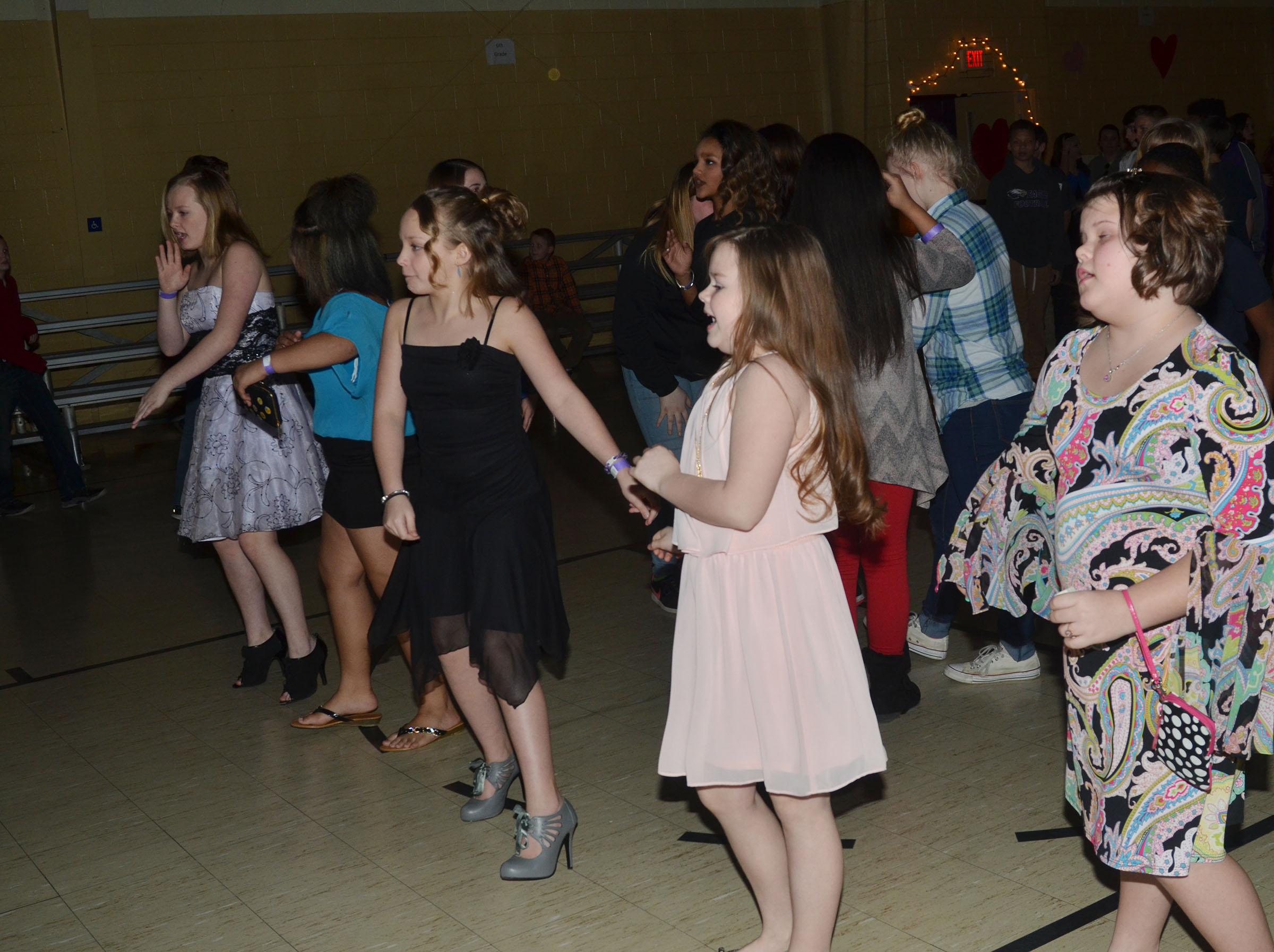 CMS students dance together.