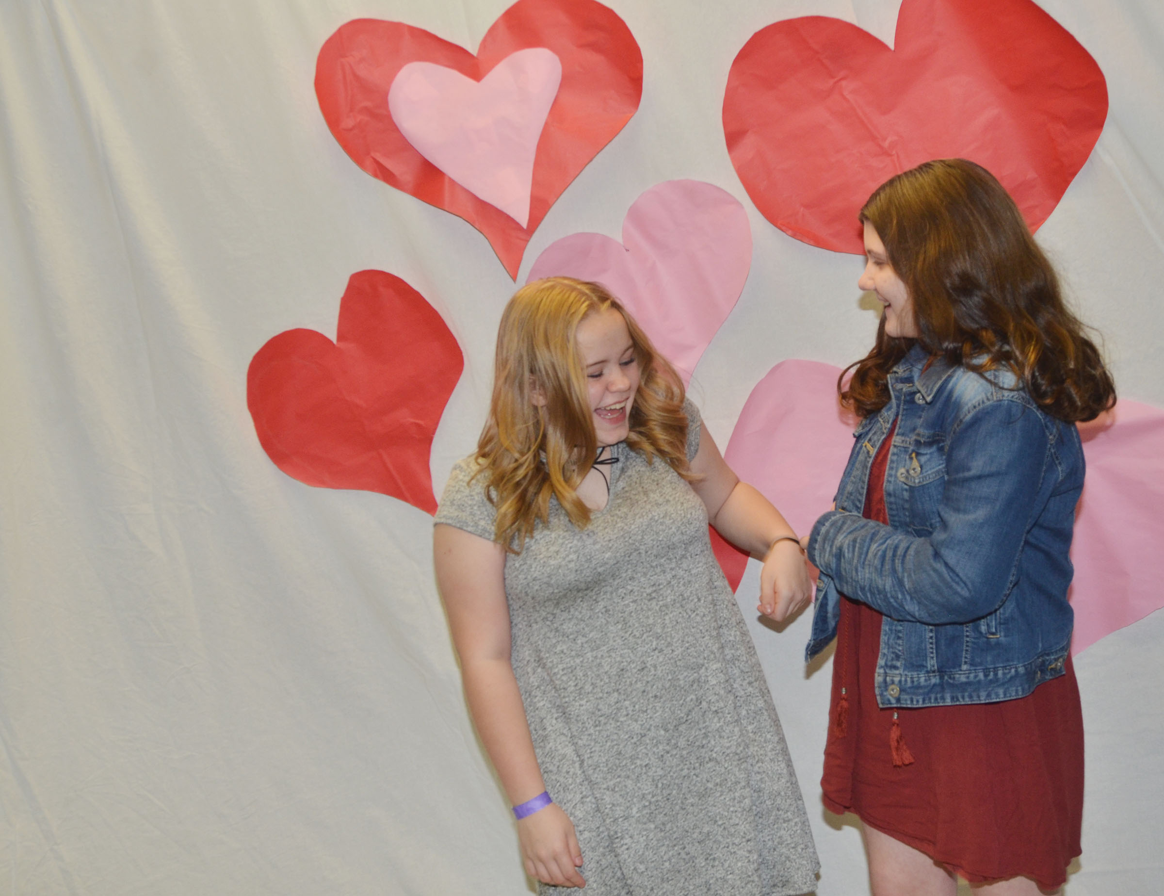 CMS seventh-graders Riley Rainwater, at left, and Skyler Olinski share a laugh before they take a photo together.