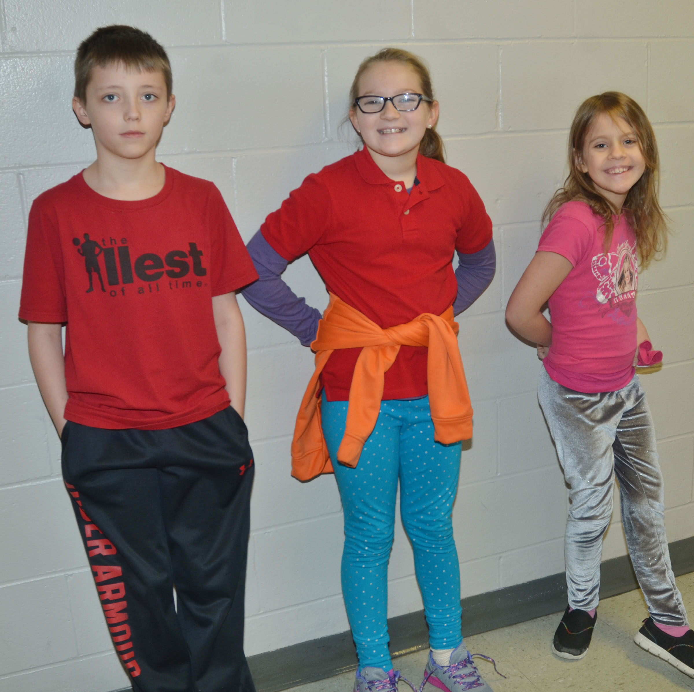 CMS fourth-graders, from left, Jaxon Garrett, Lilyan Murphy and Ellie Wise dress for Thrift Shop Day.