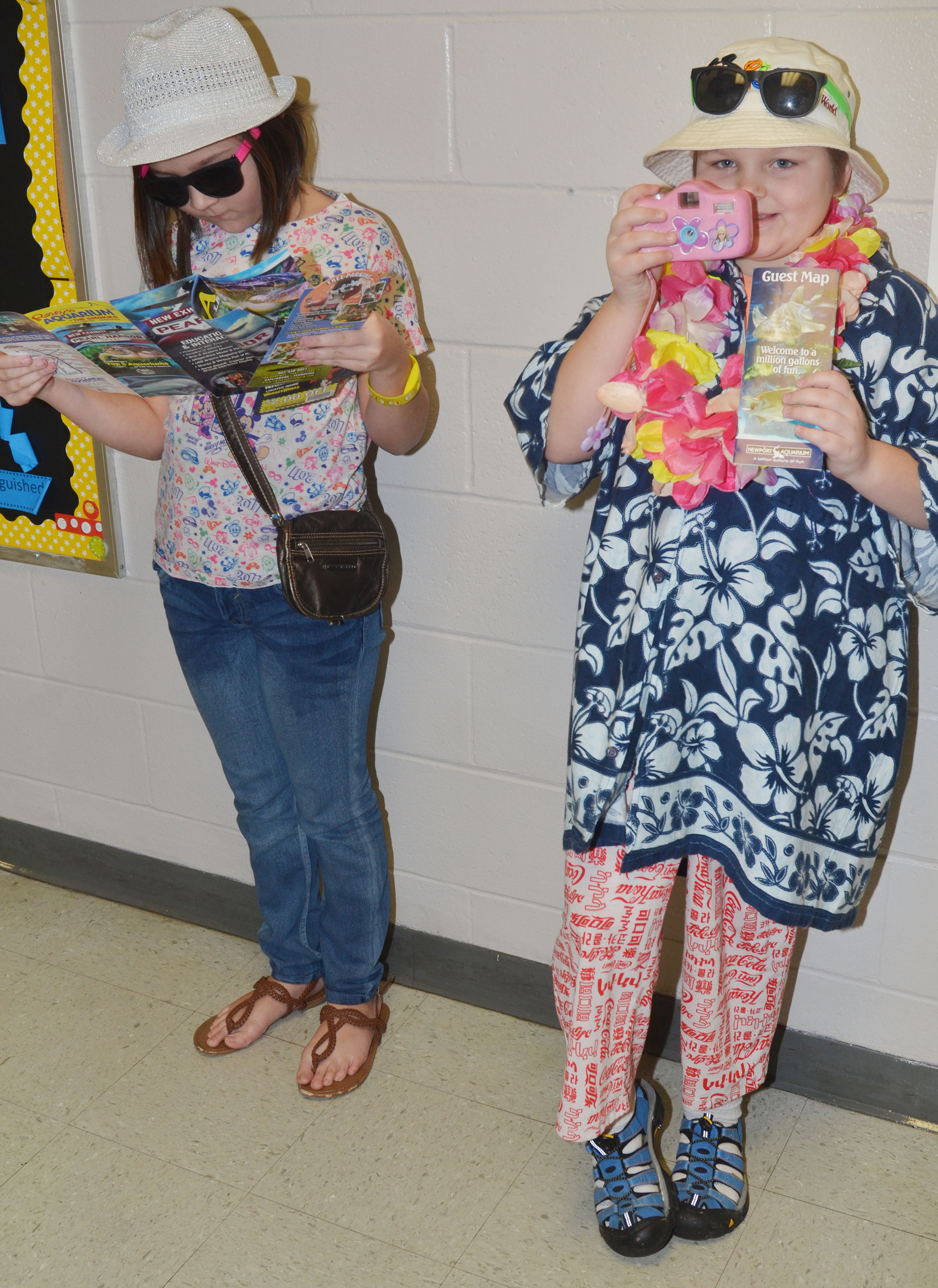 CMS fourth-graders Cassie Crick, at left, and Mellany Parker dress for Tacky Tourist Day.