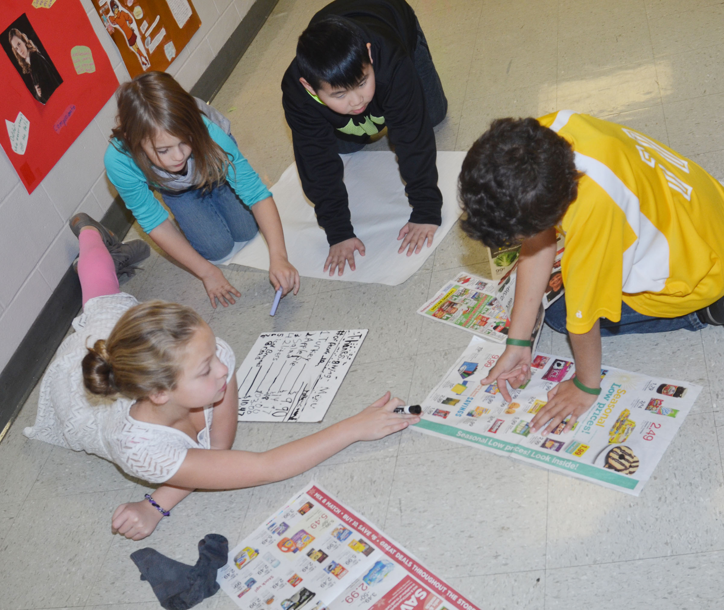 CMS fourth-graders, from left, Deanna Reardon, Ellie Wise, Zhi Chen and Darrion Mills discuss what they will have for their Thanksgiving dinner.