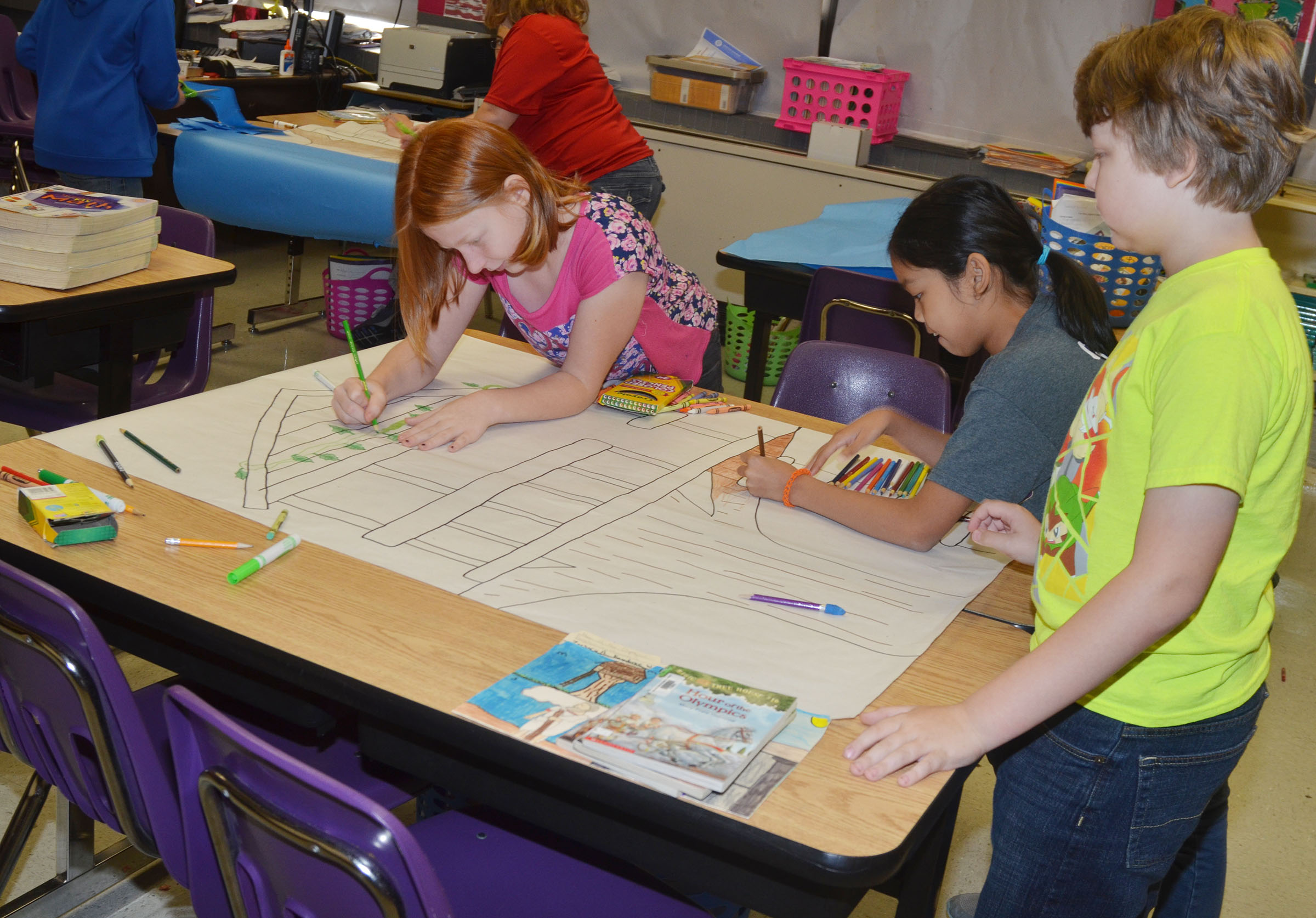 CMS fifth-graders, from left, Kaydence Wethington, Angelica Seng and Zachary Akin work on their treehouse project.