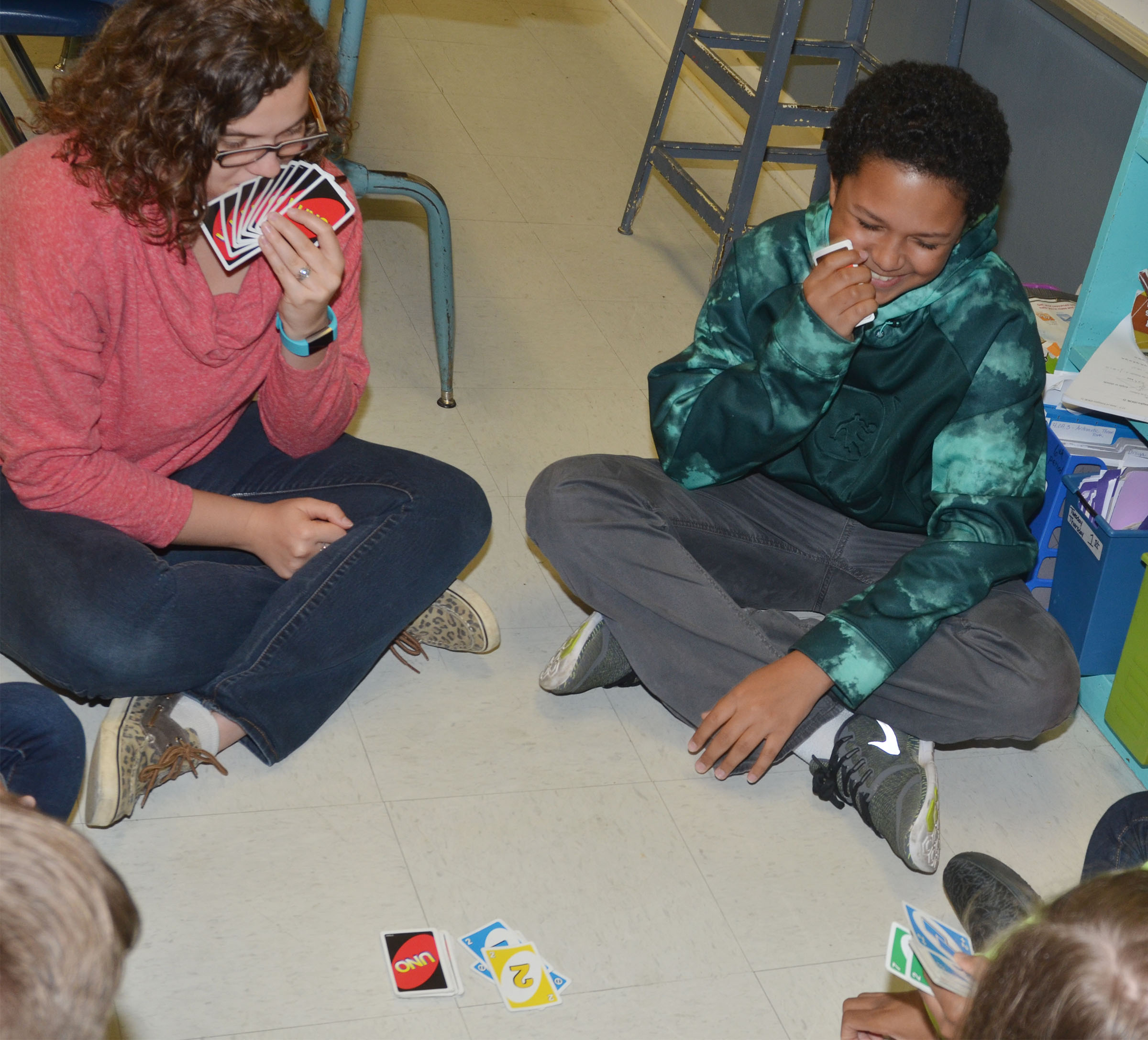 CMS seventh-grader Tezon Mitchell, at right, plays UNO with student teacher Jessica Hogue.