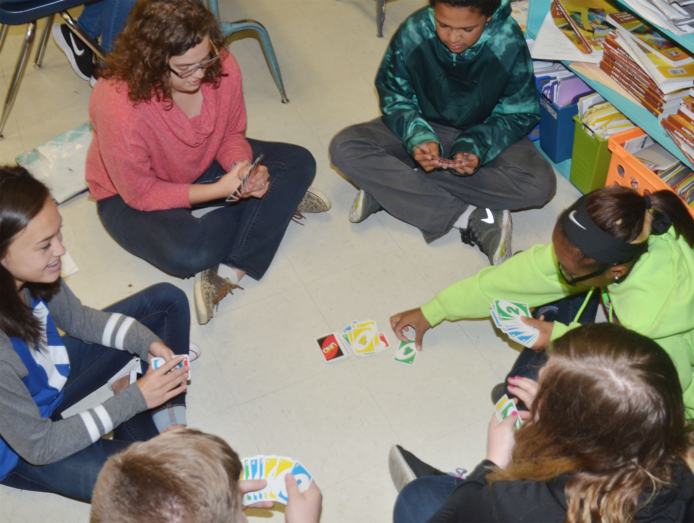 Clockwise from left, CMS seventh-grader Tayler Thompson, student teacher Jessica Hogue and seventh-graders Tezon Mitchell, Bri Gowdy and Sumara Berry play UNO.