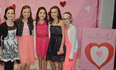 62ce8faffd23e CMS sixth-graders, from left, Sarah Adkins, Lainey Watson, Kaylyn Smith,  Tayler Thompson and Rylee Petett pose for a photo together at the dance.