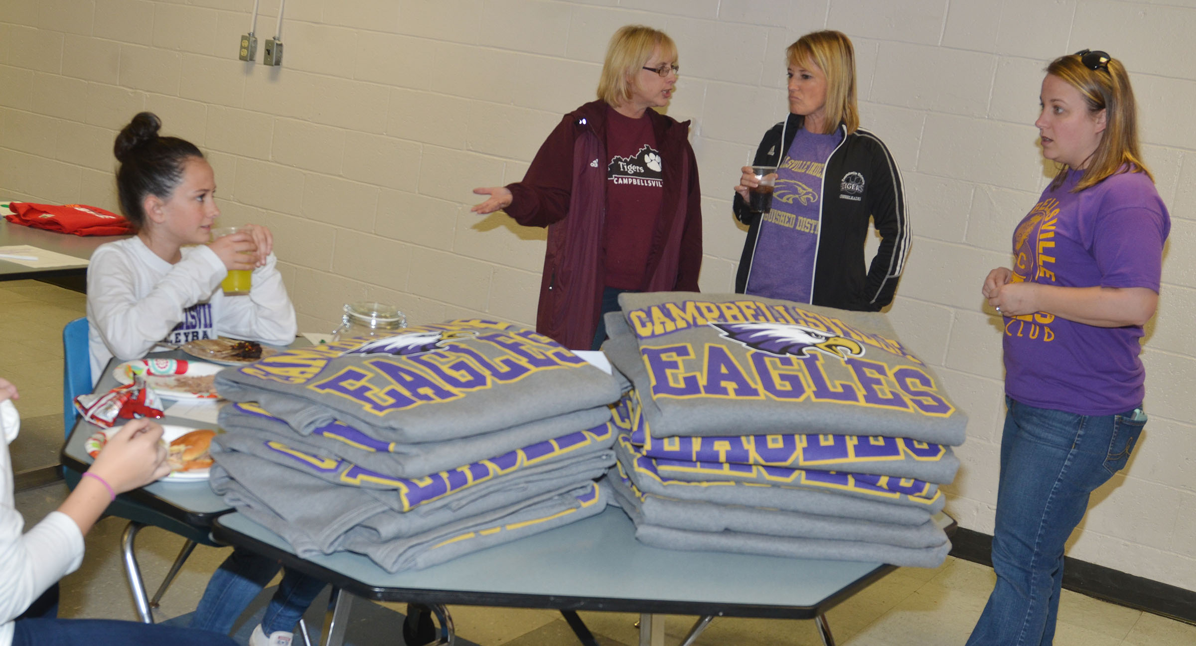 CMS volleyball player and seventh-grader Sarah Adkins, at left, sells Campbellsville Eagles blankets.