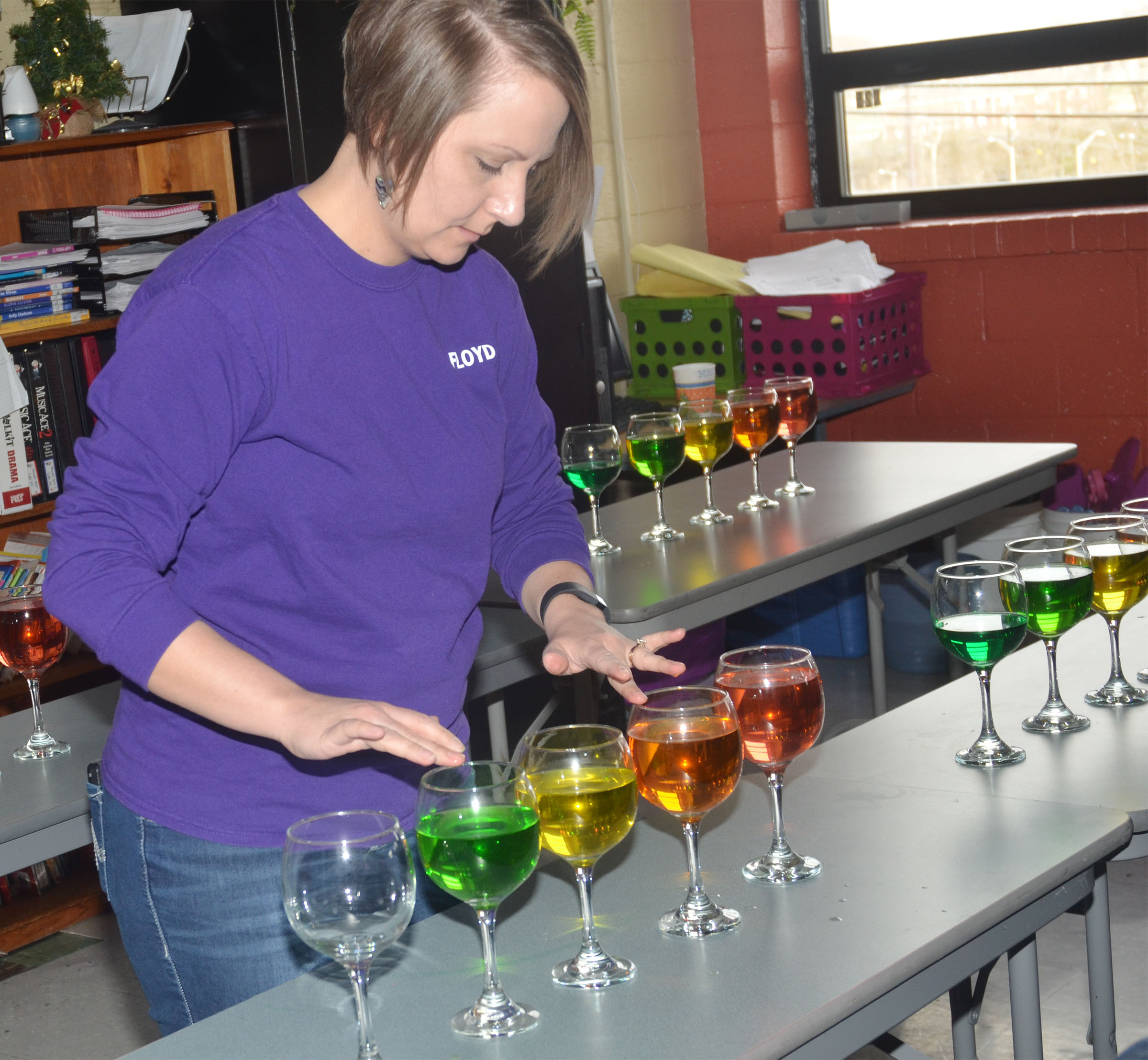CMS music teacher Jessica Floyd plays the water glasses.