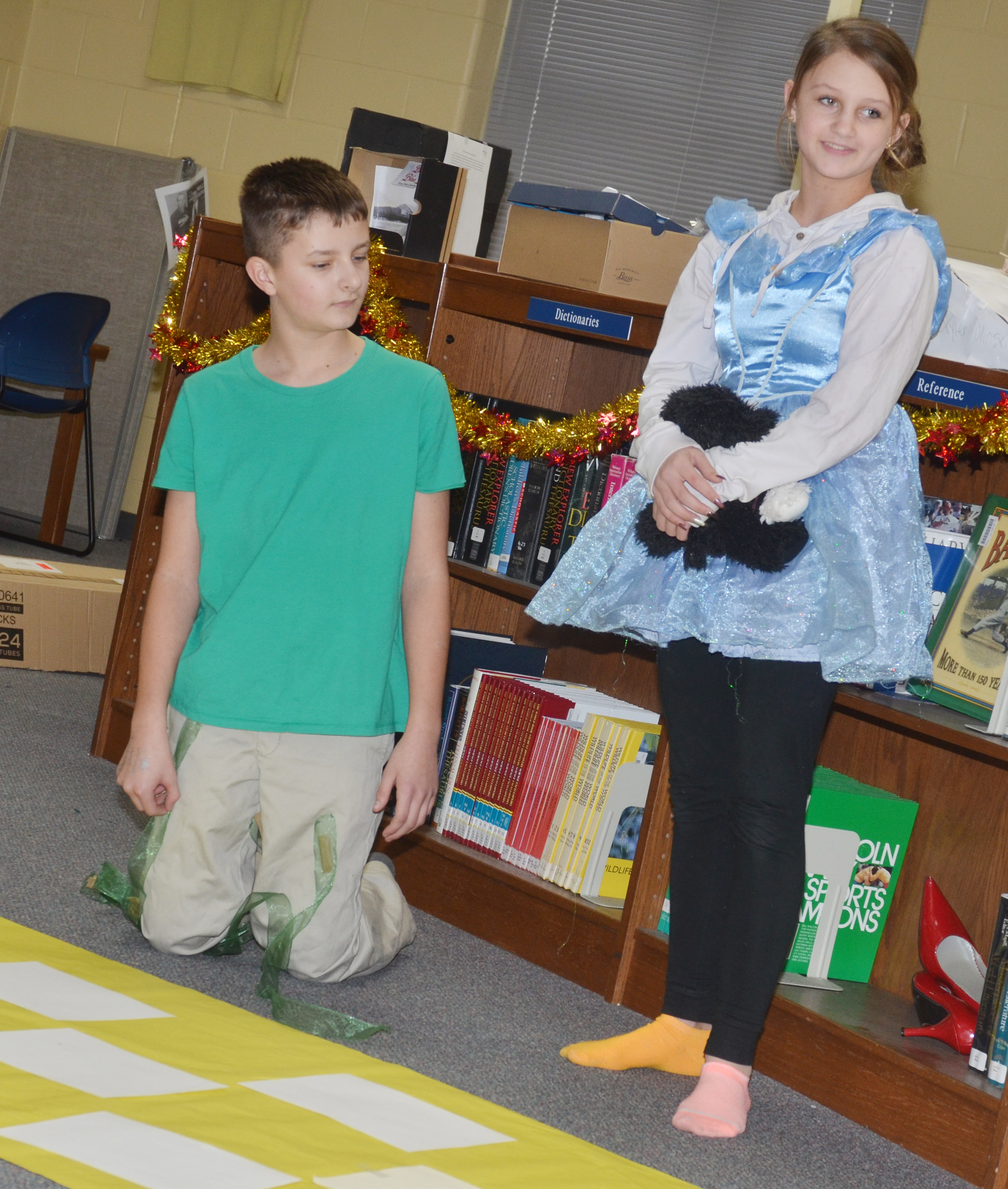 CMS seventh-graders Alexis Byers portrays Dorothy and Tyler Booth is the mayor.
