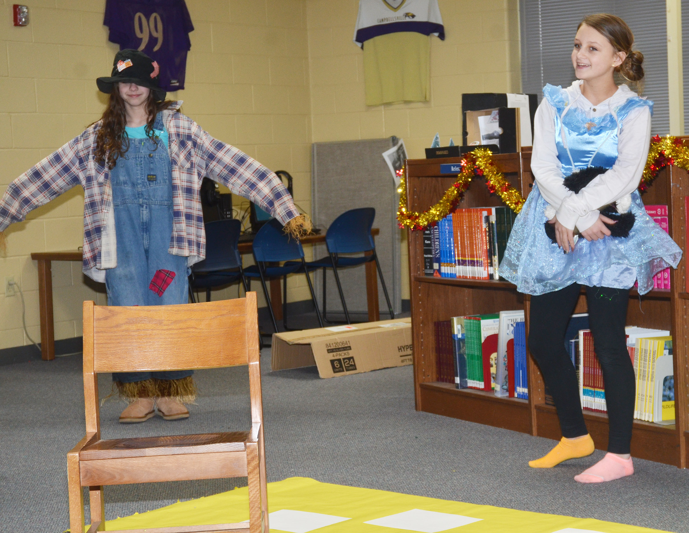 CMS seventh-graders Alexis Byers, at right, portrays Dorothy, while Karlee Rakel plays the Scarecrow.