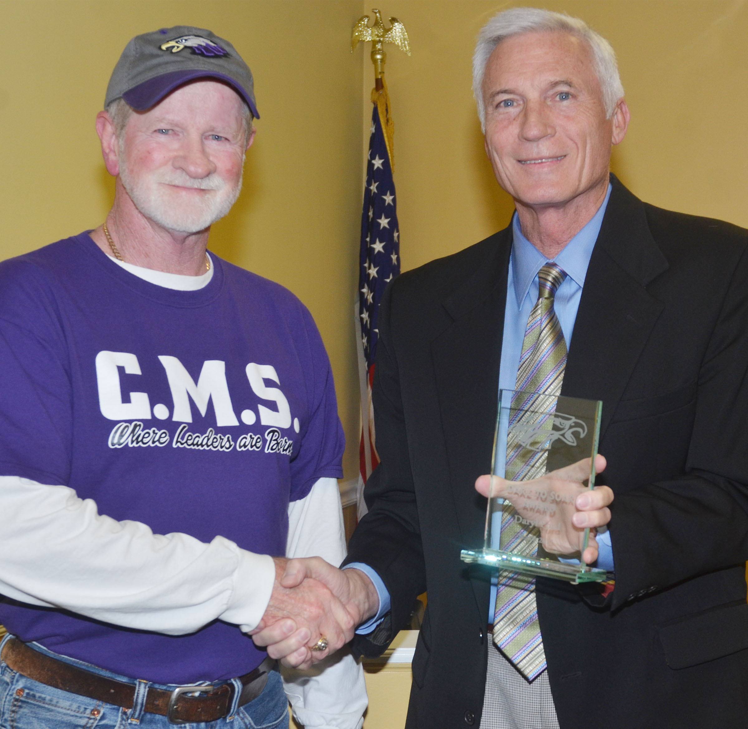 CMS custodian Daryl Ford, at left, received the Dare to Soar award at the Campbellsville Board of Education's regular meeting on Monday, March 13. Campbellsville Independent Schools Superintendent Mike Deaton made the presentation.