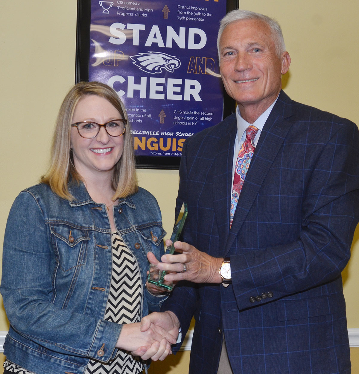 Campbellsville Elementary School reading interventionist Laura Dicken receives this month's Dare to Soar award from Campbellsville Independent Schools Superintendent Mike Deaton.