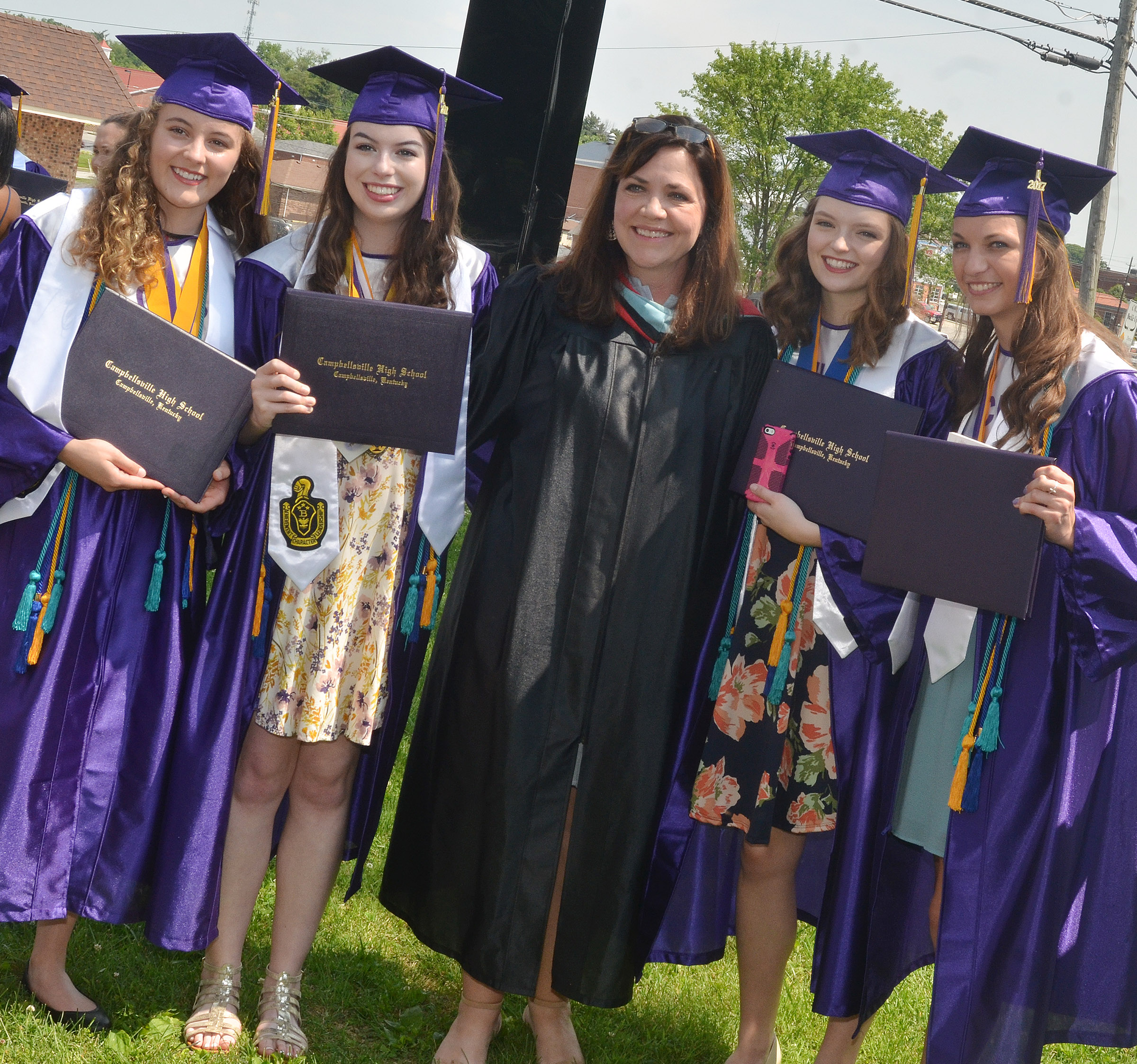 CHS teacher Susan Dabney poses for a photo with graduates, from left, Caroline McMahan, Laura Lamb, Blair Lamb and Caylie Blair.
